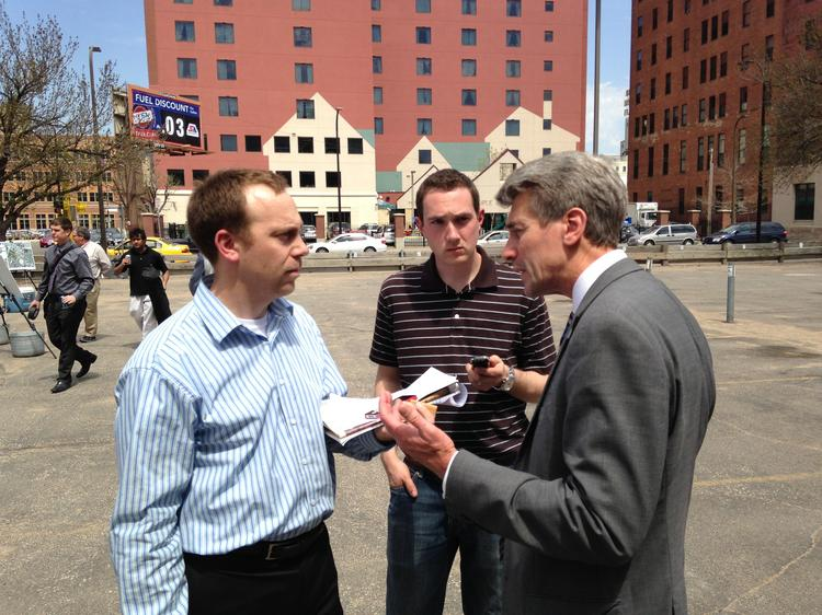 Reporters Sam Black (left) and John Vomhof Jr. (center) interview Mayor R.T. Rybak after the unveiling of the plans for the Vikings stadium park.