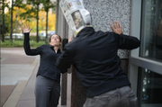 """I and art director Derek Thomson (right)  put together a series of reporter ads. In this outtake with reporter Katharine Grayson, Thomson wrapped a Business Journal around his face for a possible ad headline, """"Kathy Grayson - Digging up news that may surprise you."""""""