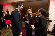 Celebrity chef and host Lorena Garcia with personal assistant Luis Corrales and Cherry Blossom Festival volunteer Pamala Jafari at the Natonal Cherry Blossom Festival's signature Pink Tie Party at the Renaissance Hotel on March 20.