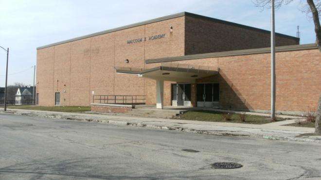 A 10-foot-long span of the Malcolm X Academy will be demolished to separate the three-story section from the one-story span that will become part of a new mixed-use project.