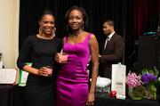 Justice Department attorney Keyonne Small, left, and Roland Pryce of World Bank at the Natonal Cherry Blossom Festival's signature Pink Tie Party at the Renaissance Hotel on March 20.