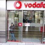 AT&T backs out of bid for Vodafone
