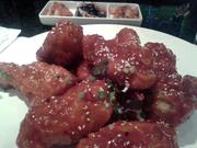 Aura's yang yum fried chicken, when done right, was light and crispy, slathered in sticky hot chile sauce.