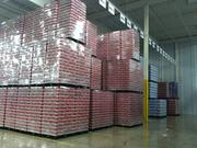 A mountain of beer inside the warehouse.