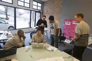 Participants work on startup Know Dat Baby, an app to help remember the names of your friends' children.