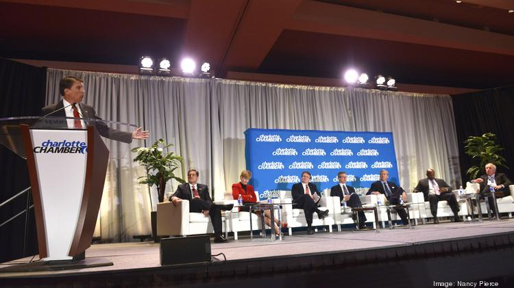 N.C. Gov. Pat McCrory (left) addresses the Charlotte Chamber's Economic Outlook luncheon, sharing the stage with a panel of top business leaders.