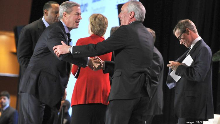 The Charlotte Chamber's annual Economic Outlook Conference was held Monday at the Charlotte Convention Center. The event featured remarks and a panel discussion with some of the city's most high-profile leaders on their predictions for the year ahead. Here, panel members greet one another.