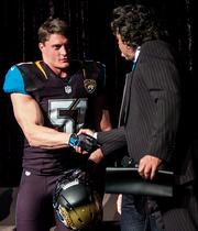 See more of the Jaguars new uniforms  Jaguars linebacker Paul Posluszny shakes hands with team owner Shad Khan during the Jaguars team press conference introducing the team's new uniforms.   Click here to see more of the uniforms.