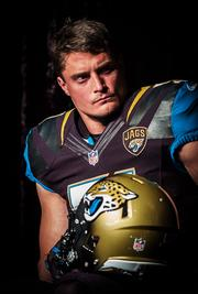 See more of the Jaguars new uniforms  Jaguars linebacker Paul Posluszny listens to team owner Shad Khan during the Jaguars team press conference introducing the team's new uniforms.   Click here to see more of the uniforms.