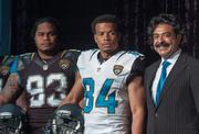 See more of the Jaguars new uniforms  Jaguars players Tyson Alualu, Cecil Shorts III stand with Owner Shad Khan during a press conference introducing the team's new uniforms.   Click here to read the story.