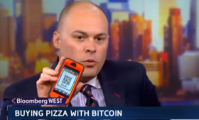 Reporter Matt Miller from Bloomberg shows his account QR code to the viewers of the morning show.