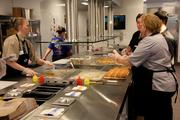 The open kitchen allows customers to see how orders come together.