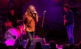 Robert Plant, Led Zeppelin front man, center, and guitarist Billy Fuller, right, perform with Sensational Space Shifters at Wolf Trap National Park for the Performing Arts in Washington, D.C., U.S., in this handout photo taken on July 22, 2013