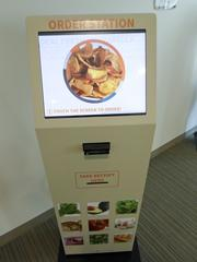 Capital One Bank's expansion includes these touchscreen stations where employees can order food and pay for it before heading to the cafeteria.