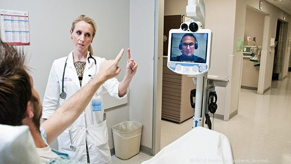 Kristen Assad, M.D. middle, and on the monitor Adrian Jarquin-Valdivia, M.D. demonstrates what it would look like to monitor a patient using telemedicine.