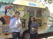 Health Care Division Manager Brian Lubbs enjoys Kona Ice on casual Friday with staff accountant Seria Tuiteleleapaga.