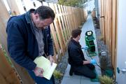 Clayton Ashley (standing, in inset above) and his son Ian (kneeling) inspect a sewer system in Seattle, part of their rounds through the region's road network that will cost their small business about $2,300 more a year once planned tolls are in place.