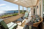 Right off the family room is an open-air, slate-tiled terrace with pergola.