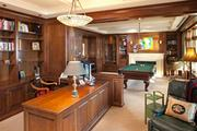 There's room for a billiards table in the paneled study and library.