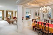 The formal dining room has a raised ceiling.