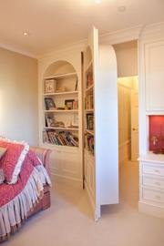 A hidden door in this bedroom suite leads to a dressing room closet off one of the master bathrooms.