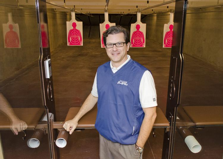 Brandon Johnson, Frisco Gun Club's marketing director, stands in the club's VIP lanes, which will soon be available to VIP members 24 hours a day via biometric access.