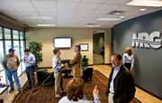 Guests socialize during an open house for Mechanical Resource Group.