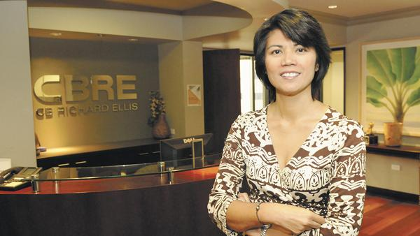 """CBRE Inc. Hawaii Managing Director Kim Lord, seen in this 2013 file photo, says the commercial real estate firm is cutting its Downtown Honolulu office space in half using the """"Workplace 360"""" model that will offer the firm's 51 employees nine different ways of working."""