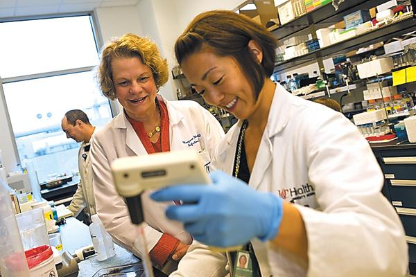 Dr. Margaret Hostetter watches research assistant Kris Orsborn work in a lab at Cincinnati Children's Hospital Medical Center. The hospital has 11 floors dedicated to pediatric research.