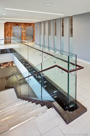 The lobby stairs present a transparent ambiance with glass panels.