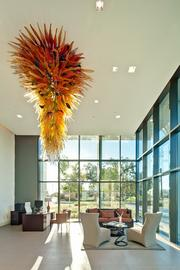The lobby of the RiverView apartments features a stunning glass art piece.