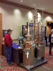Bavarian Breweries & Distilleries Inc. of Culver City, Calif. shows off one of its stills at the DSTILL craft distillers conference at the Sheraton Denver Downtown Hotel.