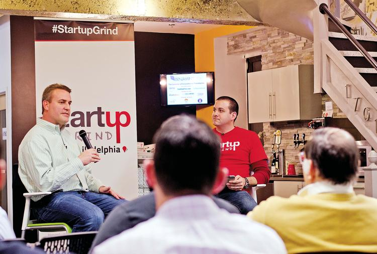 Michael Harris speaking at Startup Grind with Michael Maher (right).
