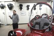Paul Moller stands in his Davis shop surrounded by aerodynamic models and a prototype of one of his Skycars. He has been working on developing a flying car for 50 years.