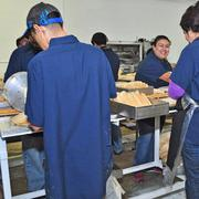 Delicious Tamales staff hard at work during the holiday season.