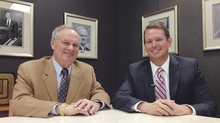 JE Dunn Construction CEO Terry Dunn (left) in December 2013 with Gordon Lansford, who took over the CEO position in January 2014.