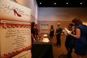 Attendees visit booths at the 2013 Corporate Philanthropy Awards, held at A La Carte Event Pavilion.