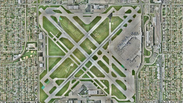 In this aerial view of Midway Airport's runway layout, Runway 13C-31C runs from the bottom right hand corner of the grid to the upper left hand corner.  It is one of the two longest runways at Midway.