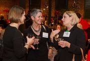 Dena Hollinger of Larson & Company PA, Ronnie Leonard of BALCO and Amy Cline of Triplett, Woolf & Garretson talk at the BizWomen Holiday Mix and Mingle Tuesday night at The Loft at 420, 420 S. Commerce.