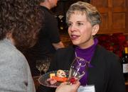 Vicki Flesher of InterAct Training Group at the BizWomen Holiday Mix and Mingle Tuesday night at The Loft at 420, 420 S. Commerce.