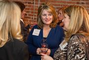 Dyan Thornton of IMA Inc. at the BizWomen Holiday Mix and Mingle Tuesday night at The Loft at 420, 420 S. Commerce.