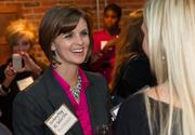 Kimberly May of Kansas Secure Title at the BizWomen Holiday Mix and Mingle Tuesday night at The Loft at 420, 420 S. Commerce.