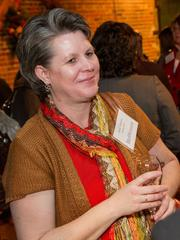 Julie Huber of Equity Bank at the BizWomen Holiday Mix and Mingle Tuesday night at The Loft at 420, 420 S. Commerce.