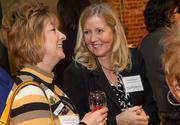 Delinda Royse of Wichita State University (right) and Belinda Venters of the WSU Fondation at the BizWomen Holiday Mix and Mingle Tuesday night at The Loft at 420, 420 S. Commerce.
