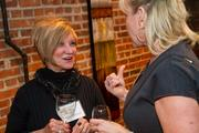Pat Peppard, owner of The Loft at 420, speaks with a guest during the BizWomen Holiday Mix and Mingle Tuesday night at The Loft at 420, 420 S. Commerce.