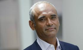 Aereo co-founder and CEO Chet Kanojia holds one of the company's tiny antennas. The firm uses the antennas to capture broadcast TV signals, which are streamed over the Web to consumers.