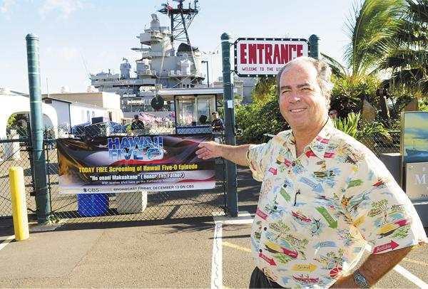 Michael Carr points to a sign that invites visitors to the USS Missouri to a  free screening of tonight's 'Hawaii Five-0' episode on CBS.