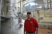 Scott Vail, senior general manager of the Houston brewery, stands next to one of the brew kettles.