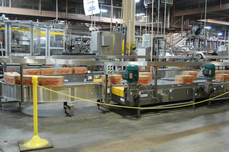 Anheuser-Busch InBev is acquiring Blue Point Brewing Co., a New York microbrewery. An Anheuser Busch plant is pictured here in Houston.