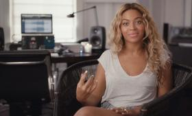 Beyoncé talks directly fans in a Facebook video in which she explains why she came out with a surprise 14-track album that includes 17 music videos.